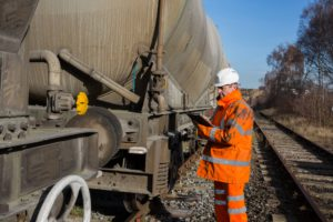 A railway workman inspecting a large goods wagon or tanker at the rail side ⭐️NOMINATED ⭐️